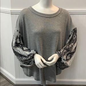 Gray shirt with snake skin sleeves size small